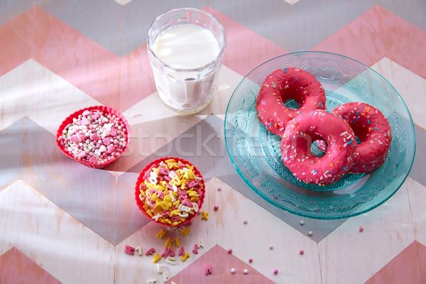 Kids party with milk pink donas and cupcake topings Stock photo © lunamarina