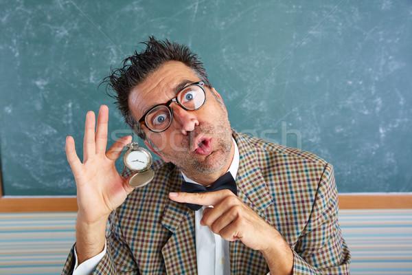 Nerd silly teacher showing vintage chain watch Stock photo © lunamarina