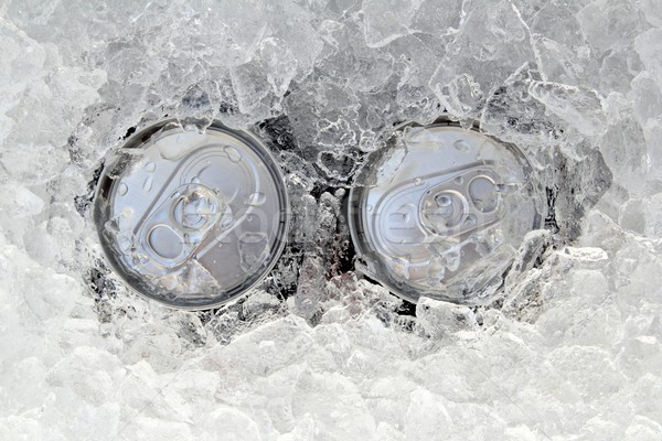 two drink can iced submerged in frost ice Stock photo © lunamarina