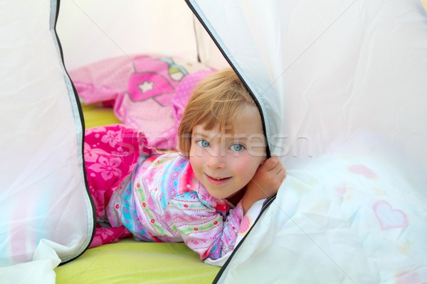 girl in camping tent lying on camp tent Stock photo © lunamarina