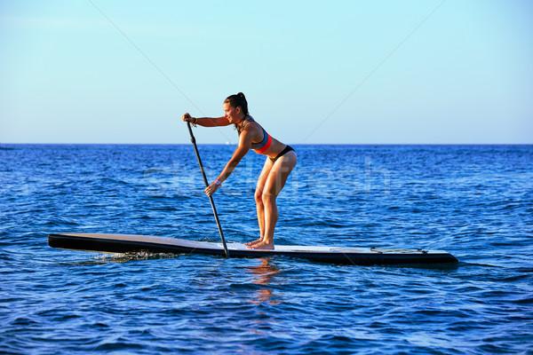 SUP Stand up Surf girl with paddle Stock photo © lunamarina
