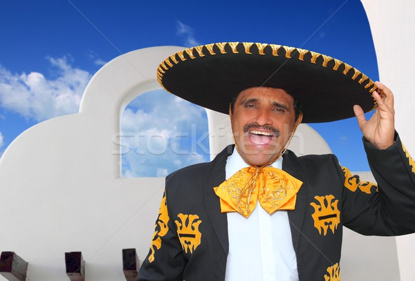 Charro mariachi portrait singing in mexican house Stock photo © lunamarina
