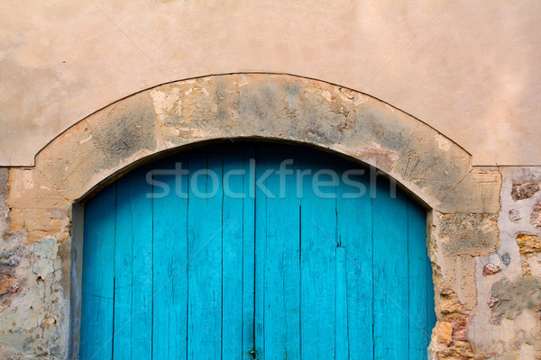 Arch wooden Mediterranean door in Valedemossa Majorca Stock photo © lunamarina
