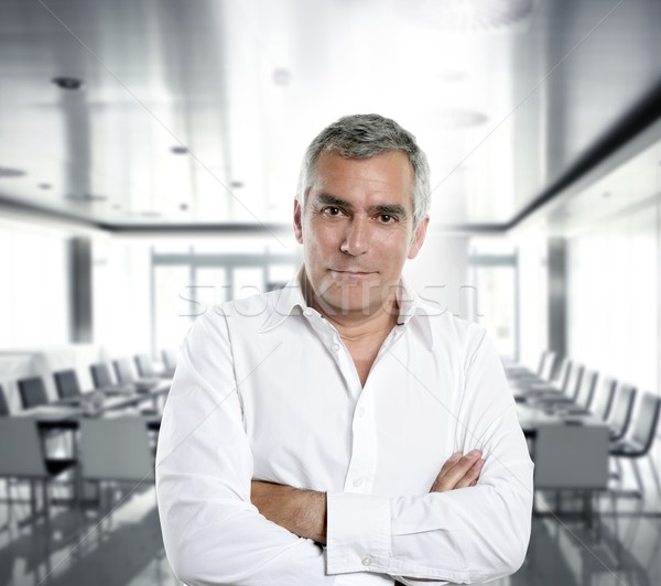 Stock photo: gray hair businessman interior white office