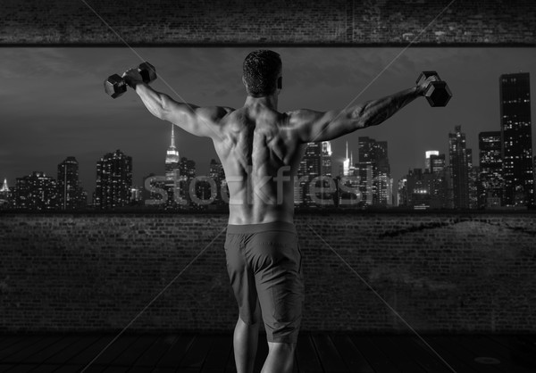 Fitnessstudio Mann Aufgang Hanteln New York City Skyline Stock foto © lunamarina