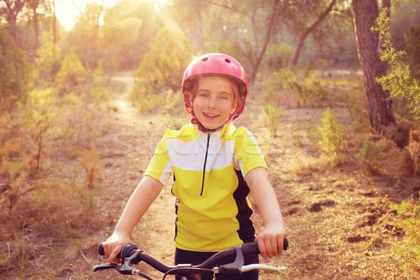 kid girl biker in mountain bike MTB Stock photo © lunamarina