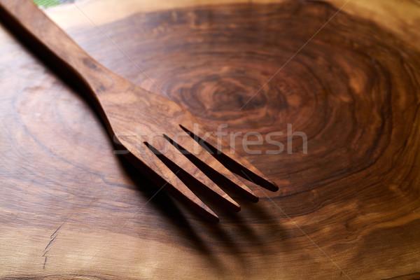 Olive wood fork on wooden cutting board Stock photo © lunamarina