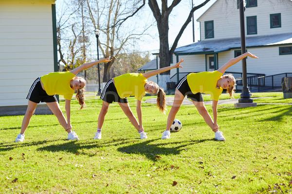 Teen girls exercise workout at park Stock photo © lunamarina