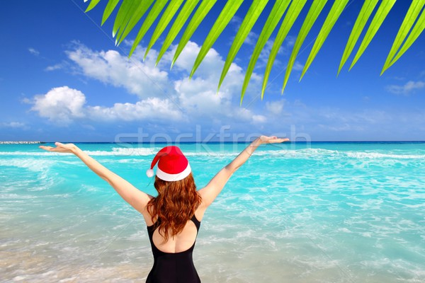 santa woman tourist christmas caribbean vacation Stock photo © lunamarina