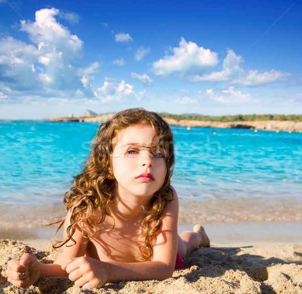 beautiful little girl in sandy beach of Ibiza Stock photo © lunamarina
