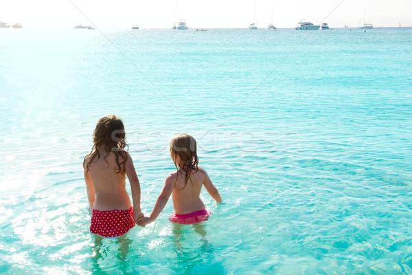 Kinder Mädchen Rückansicht Strand Sonnenuntergang schauen Stock foto © lunamarina