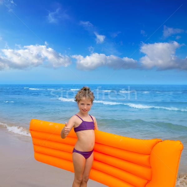 children kid girl playing in beach floating lounge Stock photo © lunamarina