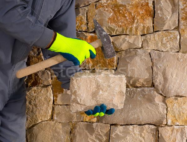 stonecutter mason with hammer and stone working masonry Stock photo © lunamarina