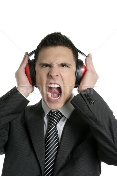 Businessman protecting from noise with headphones Stock photo © lunamarina