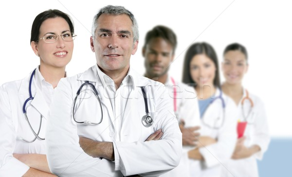 expertise doctor multiracial nurse team row Stock photo © lunamarina
