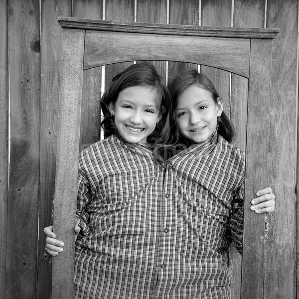 twin girls fancy dressed up pretending be siamese in frame Stock photo © lunamarina