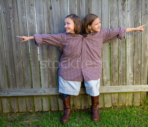 twin girls dressed up as siamese with his father shirt Stock photo © lunamarina