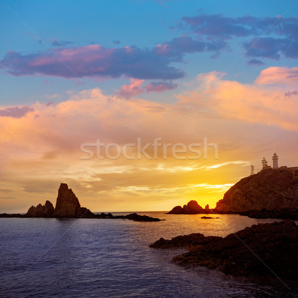 Deniz feneri gün batımı İspanya akdeniz deniz gökyüzü Stok fotoğraf © lunamarina