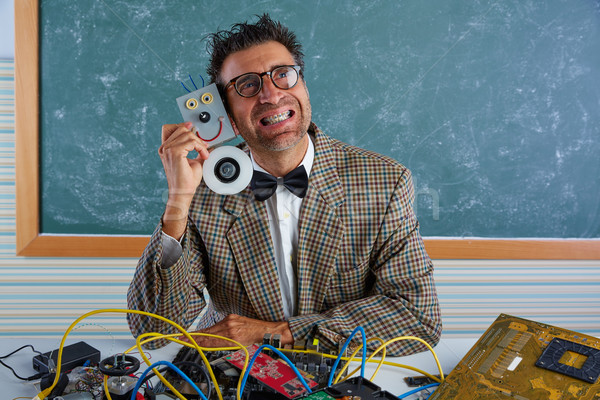 Nerd electronics technician silly hug a robot Stock photo © lunamarina