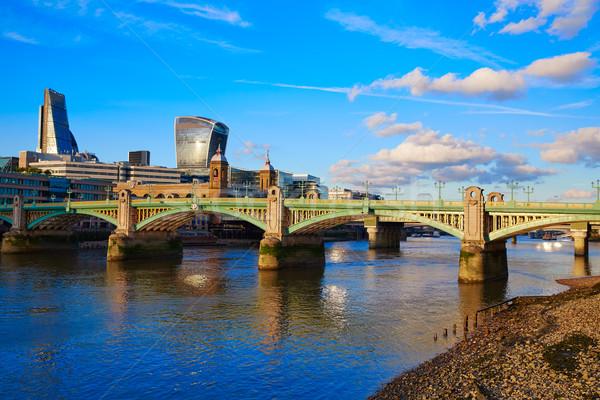 Londen brug theems rivier stad zonsondergang Stockfoto © lunamarina