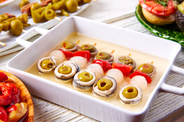 Olives anchovies and picked onion pinchos Stock photo © lunamarina