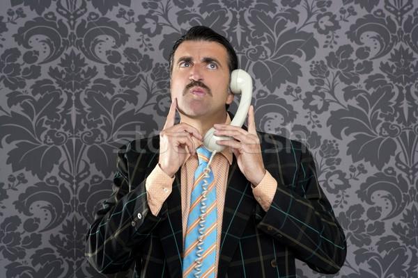 Nerd scared expression businessman telephone call Stock photo © lunamarina