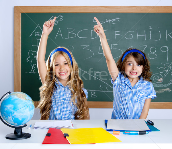 clever students in classroom raising hand Stock photo © lunamarina