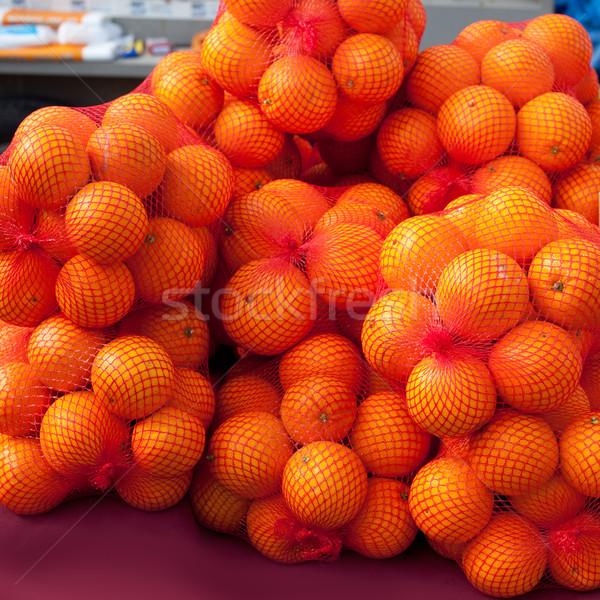 Narancsok gyümölcs piac net szatyrok piros Stock fotó © lunamarina
