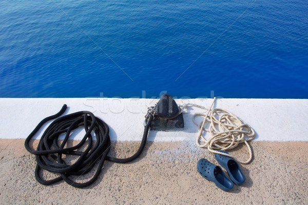 Boat noray marine rope and shoes in marina Stock photo © lunamarina