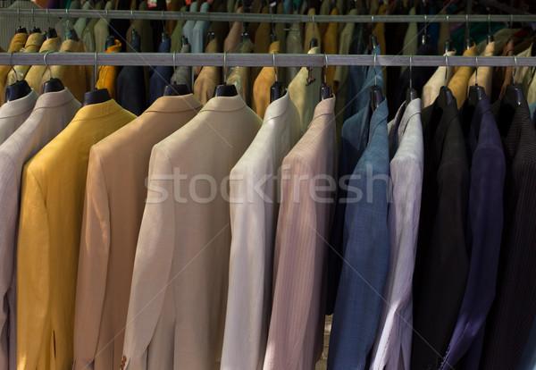Színes férfi öltönyök csetepaté vállfa divat Stock fotó © lunamarina