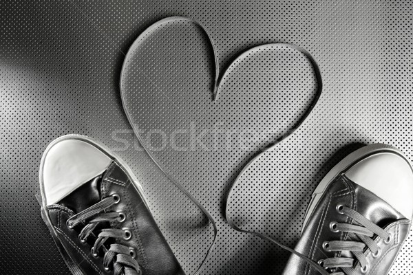 Laces of silver shoes Stock photo © lunamarina