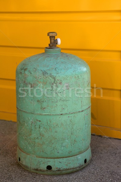 Camping gas container, green over yellow Stock photo © lunamarina