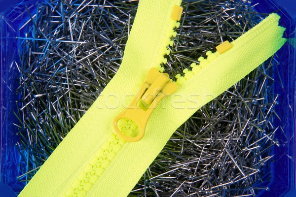 Dressmaker pins background with yellow zip Stock photo © lunamarina
