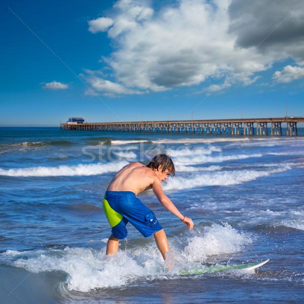 Boy surfer surfing waves on the Newport beach Stock photo © lunamarina
