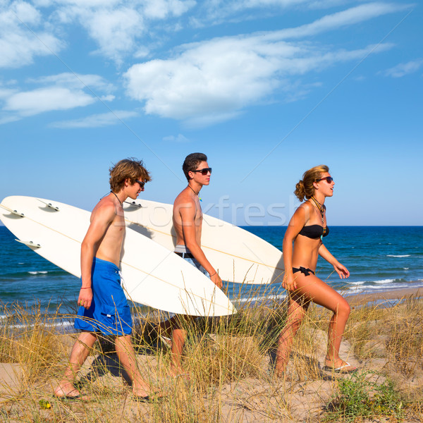Surfer teen group walking on dune way to beach Stock photo © lunamarina