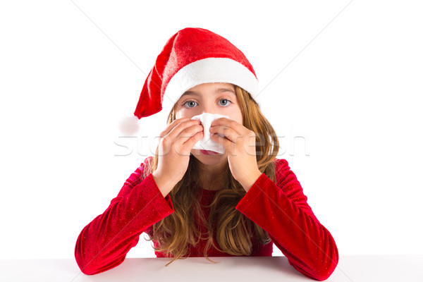 Christmas Santa kid girl blowing her nose in a winter cold Stock photo © lunamarina