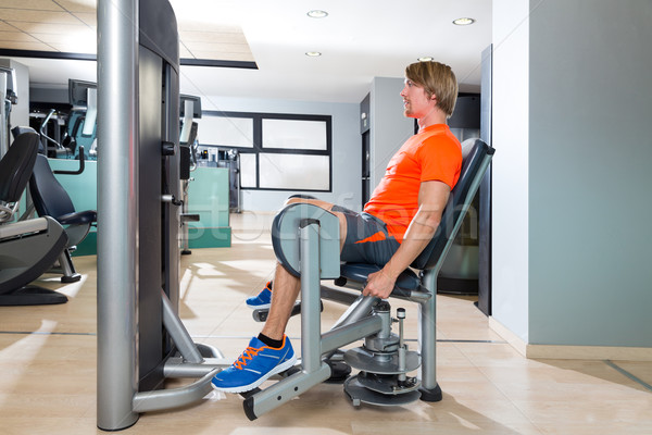 Hip abduction blond man exercise at gym indoor Stock photo © lunamarina