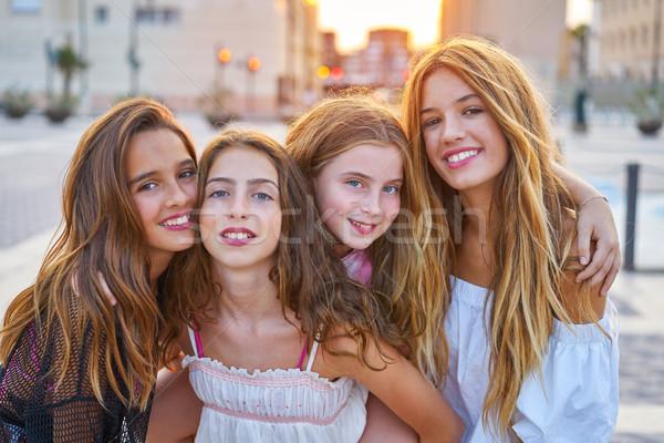 Best friends teen girls at sunset in the city Stock photo © lunamarina