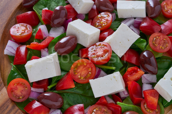 Cheese salad with tomatoes spinach and olives Stock photo © lunamarina