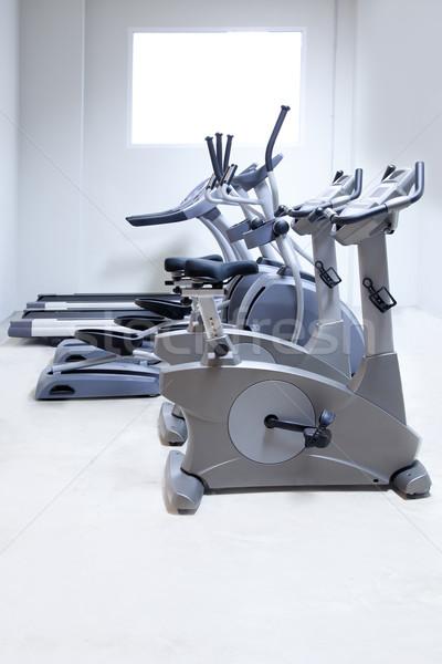 elliptical cross trainer, stationary bicycle treadmill  Stock photo © lunamarina