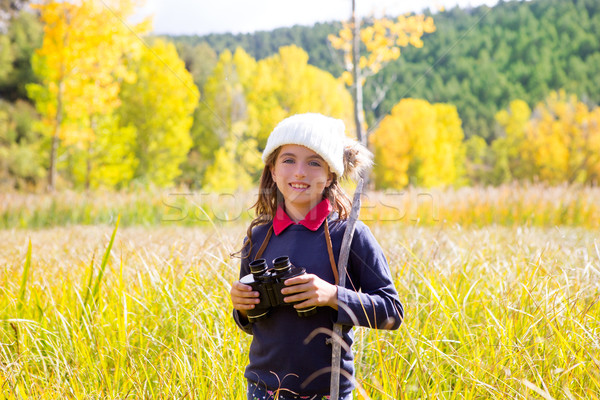 Explorer binocuar kid girl in yellow autumn nature Stock photo © lunamarina