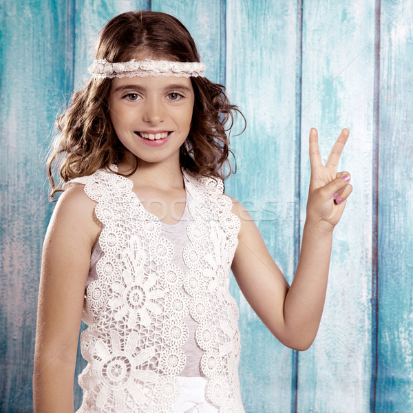 Happy hippie children girl smiling with peace hand sign Stock photo © lunamarina