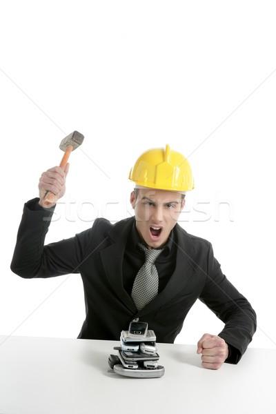 Angry businessman, hammer against telephones Stock photo © lunamarina