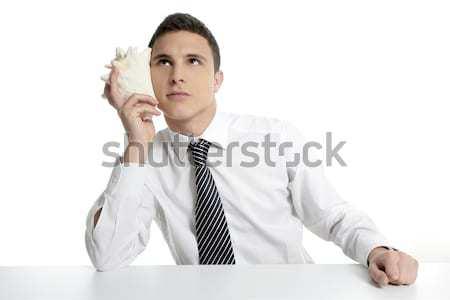 Businessman with sea shell isolated on white Stock photo © lunamarina