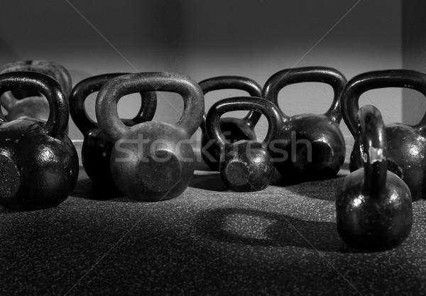Kettlebells weights in a workout gym Stock photo © lunamarina