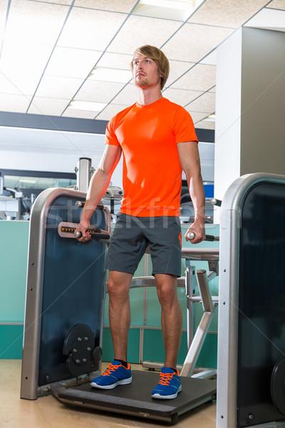 Gym squat machine exercise workout blond man Stock photo © lunamarina