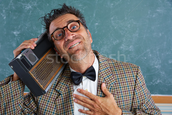 Nerd silly retro man with braces and vintage radio Stock photo © lunamarina