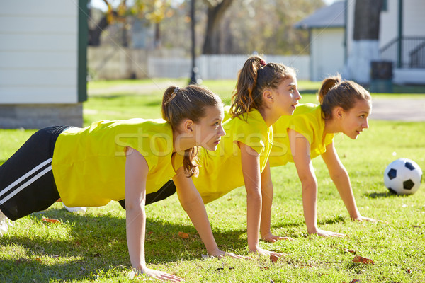 Friend girls teens push-ups workout at park Stock photo © lunamarina