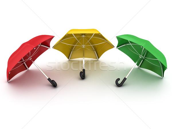 Drie gekleurd parasols witte groene Rood Stockfoto © Lupen