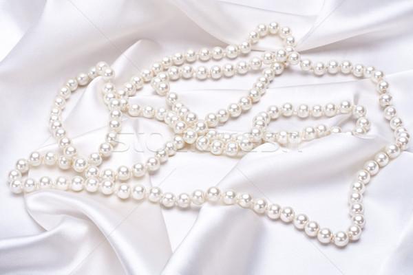 jewels on white satin Stock photo © Lupen